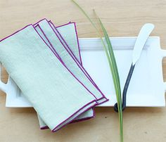 Set of 4 100% linen cocktail napkins in a gorgeous pale green linen with rolled hem trim in orchid. Many custom options available.  Our cocktail