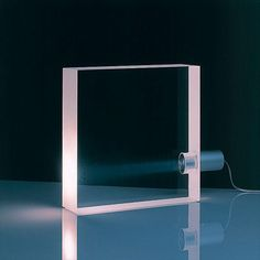 Simple and clean design with an aluminum light source.