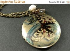 VALENTINE SALE Moth Locket Necklace. Butterfly Charm Necklace with Taupe Teardrop and Fresh Water Pearl. Handmade Jewelry. by StumblingOnSainthood from Stumbling On Sainthood. Find it now at http://ift.tt/2kDoXUl!