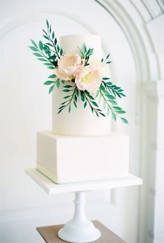 Elegant Wedding Cake by Curtis & Co Cakes   Elegant Wedding Inspiration at Cornwell Manor with Floral Design by Bramble and Wild   Bowtie & Belle Photography   Carmencita Film Lab   Baxter and Ted Films