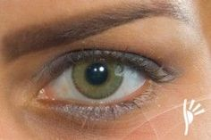 Solotica green contact on brown eye