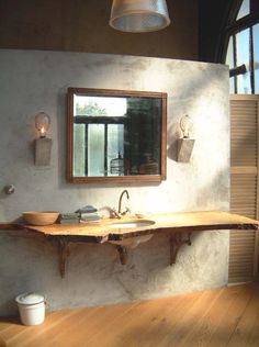 wooden slab counter top, this will look amazing with my bucket as a sink ;) maybe some deer antler around the mirror?