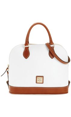 The modern dome shape of this bag is so chic!