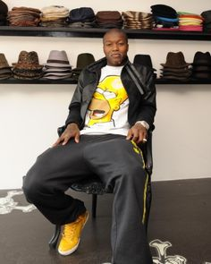 Djibril Cisse wearing a Homer Simpson T-shirt while sitting in a hat shop. So, nothing to see here then.