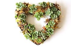 Succulent Wedding Centerpiece in Heart Shape | 35 Most Creative Ideas for Succulents in Weddings | http://emmalinebride.com/modern/succulents-in-weddings/