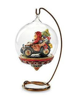 Your imagination will come to life when you hang the Santa in Classic Car Globe Ornament that features an intricate, gorgeous and joyous design.