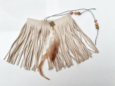 Feaux suede armlet with fringes. This upper arm bracelet has a lovely light brown color.