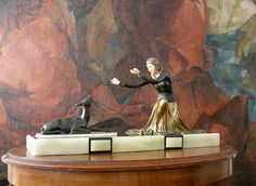 Art Deco figure of a woman.  Ivoreen head and hands. Circa 1925.   Signed MENNEVILLE. Excellent condition.