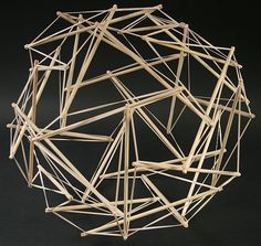 Bouncy structure made of dowels and rubber bands in which no sticks directly touch each other known as a tensegrity ball.