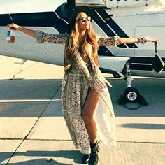 Beyoncé wearing a Brixton Messer Fedora hat, a Saint Laurent Long-Sleeve Multi Floral-Print Dress, Sunday Somewhere Isabella Sunglasses, a Saint Laurent Fringed Suede Vest, a Givenchy Triangle Mini Nappa Leather and Studs Wristlet and Miu Miu Leather Studded Mid-Calf Boots. #beyonce #style