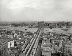 """New York circa 1903. """"East River and Brooklyn Bridge from Manhattan."""" Among the many signs competing for our attention are billboards for """"Crani-Tonic Hair Food"""" and Moxie."""