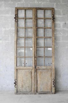 This pair of century French Doors were reclaimed from a Maison Bourgoise in the Isère Region Village of Saint-Marcellin. These walnut doors feature 24 panes of glass and antique hardware. At almost 9 feet high, these french doors would Antique French Doors, Glass French Doors, Vintage Doors, Glass Doors, French Antiques, French Country Rug, French Country Living Room, French Country Decorating, Door Design Interior