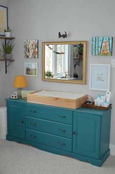 Vintage Dresser Painted Turquoise - such a great touch to the nursery!