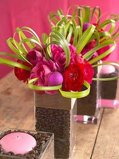 Cute centerpiece idea. You will need a large container and then a smaller container that can nestle inside the larger container. The large container will hold your lovely legumes while the smaller container will actually hold the flowers and the water. Once you have both containers in place, slowly pour your beans of choice into the space between both containers; keep the smaller vase centered as best as you possibly can. As soon as the beans are snugly set, let your imagination run wild!