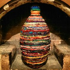 Very large recycled glass bottle. Hand wrapped in Sari Silk Yarn.