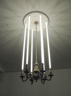 Tube Lighting Metallic Chandelier Lighting Decor Idea for a club.