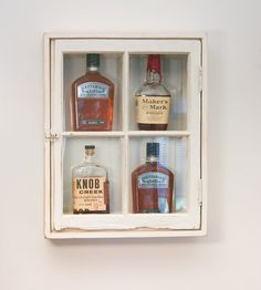 Made from an upcycled window, this little cabinet is perfect for displaying the finer spirits in your stash | Whiskey Wall Cabinet with Windows #product_design