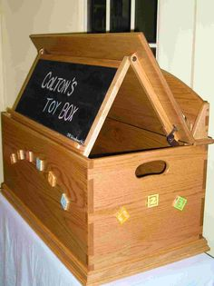 Toy box with clever fold down chalk board by Dennis DeMorest