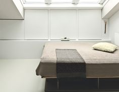 The bed, also by Hynam, is on casters, allowing ten Hompel to move it to gaze at the stars. hidden storage in walls