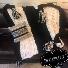 This cozy is made with black and white yarn and is a combination of crochet and knit, which make a beautiful pattern together. The black and white combination and one large tassel on each corner sets it from the rest. It's 6'L x 4.8'W, so it's perfect for a sofa, and easily large enough for two to snuggle under. As a BONUS, I'm thowing in a free coordinating throw pillow that looks great with this cozy!