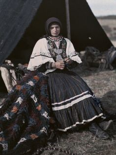 Woman Sits Outside Tent Wearing Dress of Her Tribe, the Kutzo-Vlachs By: Maynard Owen Williams National Geographic's Greece in Color from the 1920s Photographer: Maynard Owen Williams in the 1920s