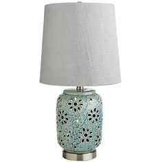 The classic look of lace takes new shape in our charming table lamp. The ceramic base features a lacy, floral design in appealing aqua. Give it a front-row spot on your favorite side table, or put it next to your bed to brighten your mornings. Either way, it will make a sweet, stylish addition to your home.