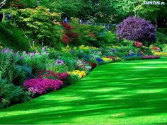 Beautiful lush lawn and flowerbeds in a public park. I couldn't find where this is located.
