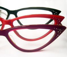 Always wanted to be the popular girl in school. Not in school anymore, but it's never too late to be a hottie. Meow.....   Make Out Queen cat eye reading glasses. In Magenta, Tramp Red, and Black.