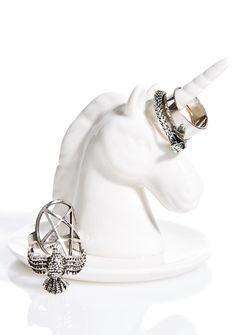 Bewitched Unicorn Ring Holder will keep yer most precious gems safe and sound. This porcelain jewelry dish features a beautiful unicorn that ya can hang, loop, and drape yer jewels over, so ya can put 'em on display, and not have to worry about them getting taken away.