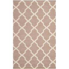 Trellis-inspired wool rug in beige. Handcrafted in India.  Product: RugConstruction Material: WoolColor: ...