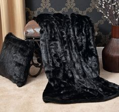 Features:  -Faux fur is incredibly soft and plush with super soft microfiber backing.  -Dry cleaning is recommended.  Color: -Blue.  Material: -Faux Fur.  Size: -Throw. Dimensions:  Overall Product We