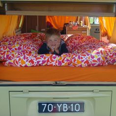 pop-top VW with queen sized bed above the roof. The lounge in the lower level converts to a double bed utilising the full width of the van.
