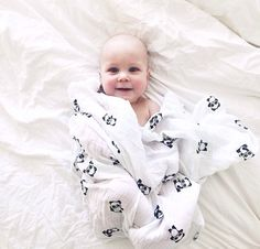 Adorable baby with Lulujo Panda blanket.
