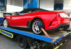 An exclusive Ferrari 599XX, on its way to its very rich owner. Note the carbon fiber detailing. Spotted in Abu Dhabi, Airport Road.