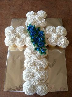 Cross cupcake cake for baptism, first communion, confirmation, christening, dedication by Mom N' Me Bakery in Fairfield Twp. OH. Check us out on Facebook!:
