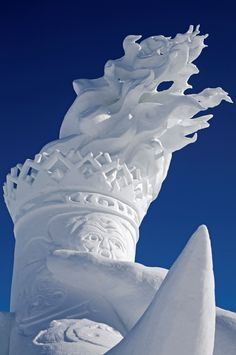 Stunning snow sculptures-Snow sculpture of Olympic torch at Whistler, British Columbia, Canada.