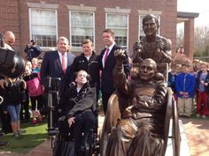 A Bronze Statue of Father and Son Running Inspires Schoolkids