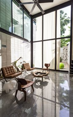 Two-Story Glass Wall Makes Narrow Mexican Home Feel Huge - http://freshome.com/two-story-glass-wall