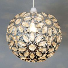 Patterned all over with daisies crafted from clear jewels, this circular ceiling pendant is finished with a neutral chrome frame.
