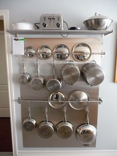 Brilliant - mount Fintorp hanging rods inside one pantry cupboard with hooks for Calphalon, and stash the lids behind.