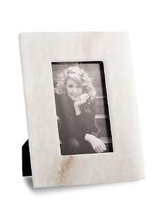 Beautifully display a favorite or cherished photo in the Orleans Alabaster Picture Frame that is masterfully constructed from smooth, natural stone.
