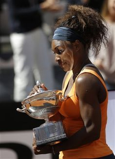 Serena Williams, of the United States, holds the trophy after winning her final match against Belarus Victoria Azarenka at the Italian Open tennis tournament in Rome, Sunday, May 19, 2013. Serena Williams won her fourth consecutive title of the year in dominating fashion Sunday, beating third-seeded Victoria Azarenka 6-1, 6-3 in the Italian Open final. (AP Photo/Andrew Medichini)