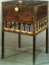 From the Tomb of Tutankhamun.The framework of this chest is made of ebony,with the insert panels probably of cedar.The lid is hinged in bronze along the back edge and folds down the back of the chest.Internally the chest is divided into compartments and below the box there is an elaborate openwork area incorporating the 'ankh' hieroglyph.