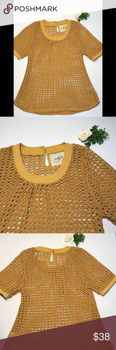 """Angel of the North (Anthropologie) Crochet Tunic NWOT  Anthropologie Angel of the North Senoia Tunic Top Women   Mustard yellow/gold color  Measurements below are approximate and were made while the garment was lying flat. Double measurements as needed.  Shoulders: 14"""" Armpits: 17.5"""" Sleeve: 12.5"""" Length: 27"""" Bottom width: 22.5""""  60% cotton, 40% polyester  Comes with extra button for back buttons Angel Of The North Tops"""
