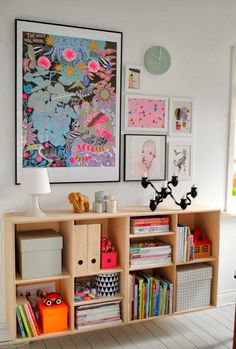Combination of a Photo Feature Wall with a colourful shelving unit = success.