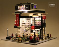https://flic.kr/p/S2cqyJ | Lego Modular MOC. Title: Speeda - Bicycle Showroom. Builder: Brandon WYC | A new bicycle brand for Lego Minifigures. This bicycle showroom is built on a 48x48 floor plate. The dimension of the building area is 32cm(W) x 34cm(H) x 32cm(D). The objective to achieve for this MOC is to create a modern and contemporary bicycle showroom with the authentic idea and unique design style. Also the scale of the whole exterior and interior design is compatible with the Leg...