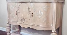 Antique Buffet goes Romantic Client brought me this beautiful antique buffet and wanted it redone in a peachy pink color with champagne highlights and fleur de…