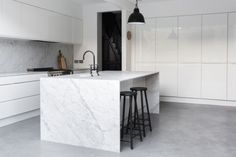 Kitchen: white handleless cabinets, pale grey and white marble splashback and benchtops, island with waterfall, grey polished concrete floor, black ba. Grey Flooring, Kitchen Flooring, Grey Kitchens, Cool Kitchens, Interior Exterior, Kitchen Interior, Interior Design, Voxtorp Ikea, White Gloss Kitchen