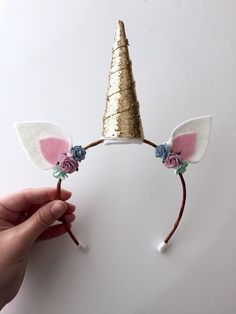 These beautiful handmade unicorn ears are perfect for any imaginative little one! They are adorned with flowers and the perfect amount of sparkle! They are extremely adjustable and are recommended for (Diy Baby Headbands) Unicorn Ears, Unicorn Headband, Unicorn Headpiece, Diy Halloween, Unicorn Halloween, Costume Halloween, Diy And Crafts, Crafts For Kids, Manualidades Halloween