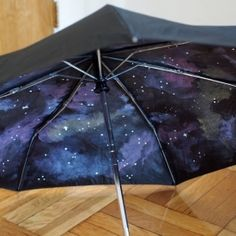 DIY: Paint your own galaxy umbrella. Open it up and you'll create a whimsical oasis in the middle of the storm. // Oh my God I love the idea I will be so excited to go outside when it rains.